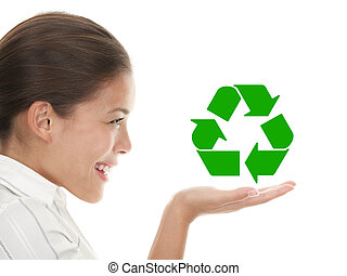 Recycling woman holding the international icon / symbol for...