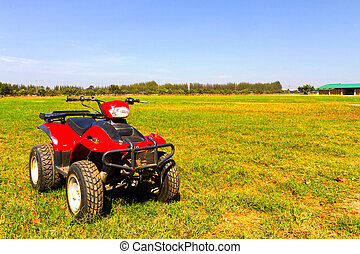 Red 4x4 ATV on the field