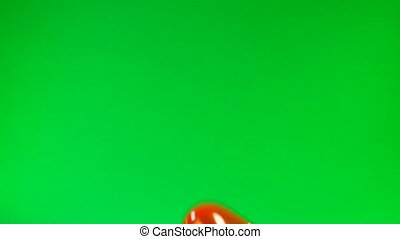 red a balloon in the form of heart on the green screen