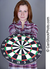 Red-ahired girl with darts.