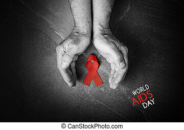 red AID ribbon in hands, flat lay