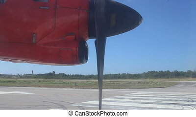 red aircraft turns at runway - red aircraft turning at the...