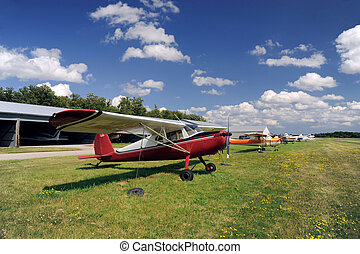 Red airplane moored on the airfield