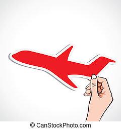 red airplane sticker in hand