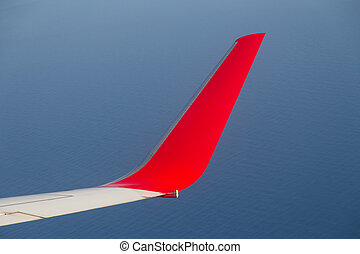 Red Airplane Wing and Wingtrip on sky