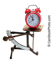red alarm bell on old letter scales