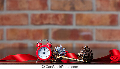 Red alarm clock and gold christmas