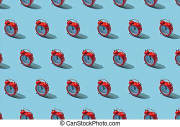 Red alarm clock on pastel blue background. Creative idea. minimal concept. Isometric, harsh light