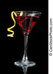 Red alcohol cosmopolitan cocktail decorated with citrus lemon tw