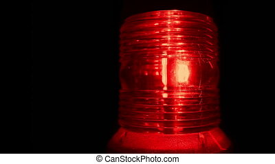Red alarm light flashing in the dark