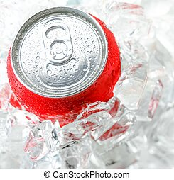 red aluminum can with water drop in the a lot of ice