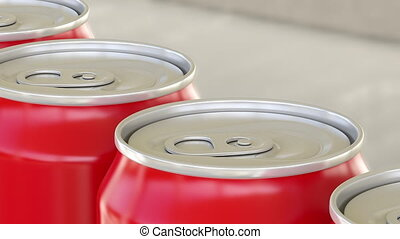 Red aluminum cans on industrial conveyor. Soda or beer...