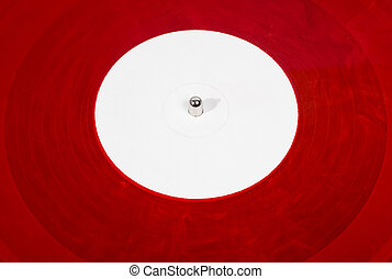Red analog vinyl disc close up white apple - Red analog ...