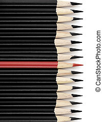 Red and Black Pencils - Row of black pencils with one red...