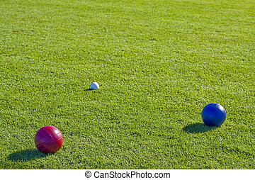 Red and Blue Bocce Balls - Colorful bocce balls on a green...