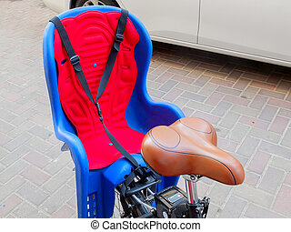 Red and blue child chair on bike.