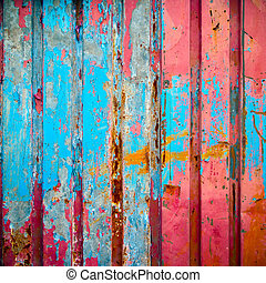 Red and blue color paint on metal wall