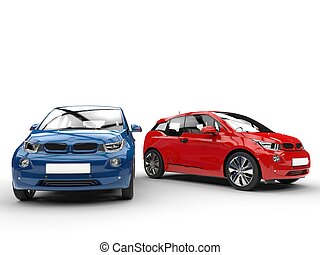 Red and blue electric cars - side by side