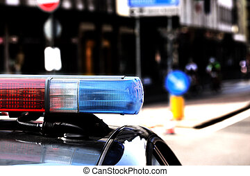 Red and blue flashing lights of the police car in the...