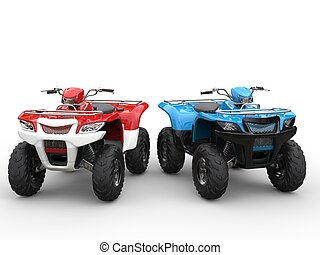 Red and blue quad bikes side by side