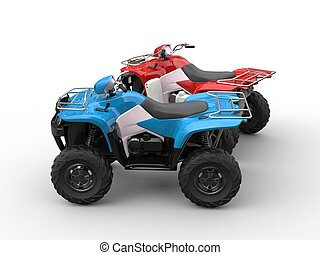 Red and blue quad bikes - side view