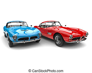 Red and blue vintage race cars - side by side