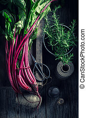 Red and fresh beetroots in a rustic kitchen