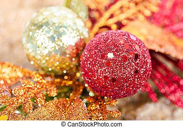 Red and gold Christmas ball with bow.