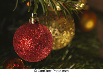 red and gold christmas decorations on tree
