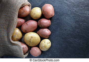 Red and Gold potatoes in hessian sack