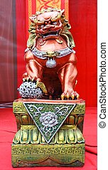 red and gold stucco lion