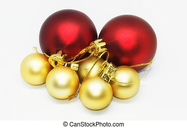 Red and golden Christmas balls on a white background
