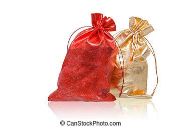 red and golden sacks over white