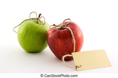 Red and green apples with card