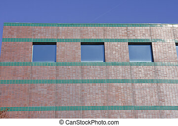 Red and Green Brick Building with Blue Windows