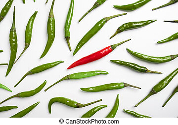 Red and green chilli peppers on a white background.