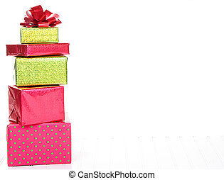 Red and Green Christmas presents stacked with an isolated white background
