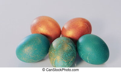 Red and green Easter eggs on white background