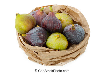 red and green figs in a basket isolated on white background
