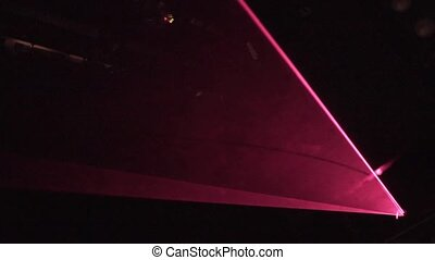Red and green illuminated spotlight in concert