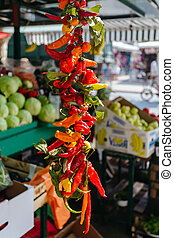 Red and green pepper hanging on the market in Omis, Croatia