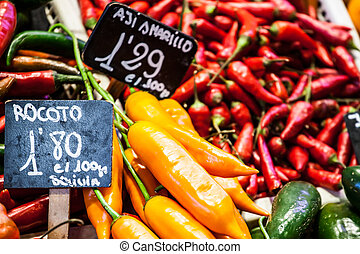 Red and green peppers hung to dry in the La Boqueria market...