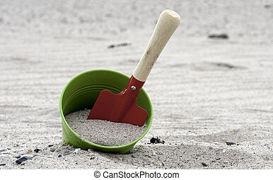 shovel and bucket on the beach - red and green shovel and...