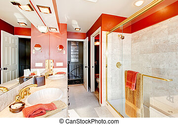 Red and marble interior of large master  bathroom with walk in glass shower.