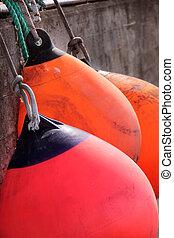 Red and orange buoys