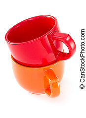 red and orange cups on white background