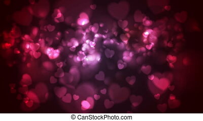 Red and pink glowing bokeh hearts video animation