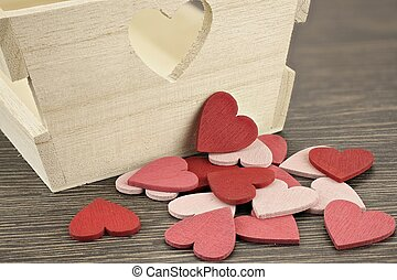 Red and pink heart in front of wooden box