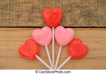 Red and pink lollipops on pallet
