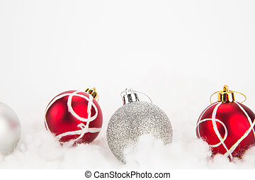 Red and silver Christmas balls on abstract background